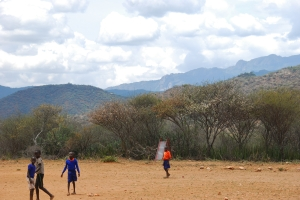 Children walk daily up to 14km EACH WAY, from the second line of mountains in this photos (the lower, darker ones) to attend school.